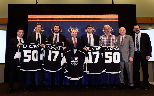 NASHVILLE, TN - JANUARY 30:  (L-R) Kelly Cheeseman, COO, Los Angeles Kings, President of Business Operations Luc Robitaille and defenseman Drew Doughty of the Los Angeles Kings, NHL Commissioner Gary Bettman, goaltender Jonathan Quick, head coach Darryl Sutter and alternate governor Dan Beckerman of the Los Angeles Kings and deputy NHL commissioner Bill Daly pose onstage to announce that the Los Angeles Kings and the Staples Center will serve as the respective host team and venue for the 2017 NHL All-Star Weekend prior to 2016 Honda NHL All-Star Skill Competition as part of the 2016 NHL All-Star Weekend at Bridgestone Arena on January 30, 2016 in Nashville, Tennessee.  (Photo by Patrick McDermott/NHLI via Getty Images)