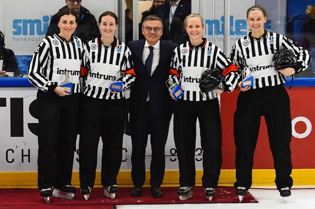 From left, Jackie Spresser, Jamie Huntley, Anna Wiegand and Jenni Heikkinen pose after working the IIHF World Women's Hockey Championship bronze medal game in Espoo, Finland, in April 2019.
